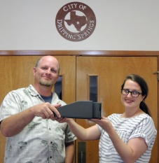 "Dripping Springs City Planning Director Jon Thompson (Left) and Deputy City Administrator Ginger Faught show off a sample dark-sky-friendly ""glare buster"" light fixture to be used for outdoor wall mounted lighting replacements. Photo: Cindy Luongo Cassidy"